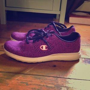 Purple champion sneakers.